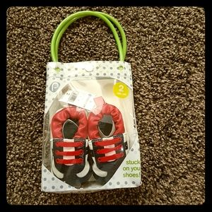 Baby's first shoes in gift bag